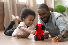 Cute Little African Kid Son Playing Toy Cars With Dad