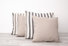 Striped And Gray Cushions On T...