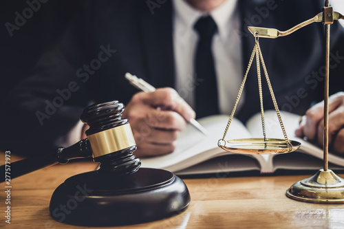 Fototapeta  Professional Male lawyer or judge working with contract papers, documents and ga