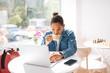 Leinwanddruck Bild - Attentive brunette man staring at screen of laptop