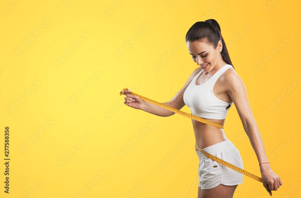 Fototapety, obrazy: Woman and tape measure.
