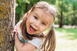 canvas print picture - Close-up portrait of an excited little girl laughing in park