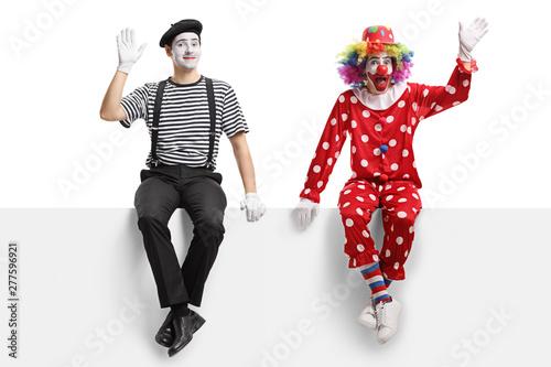 Obraz na płótnie Clown and a mime sitting on a panel and waving
