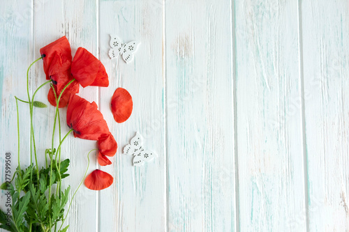 Flowers poppies on a wooden white background with copyspace. Background for a banner with poppies. Symbol of the holiday and the memory of the dead heroes. Day of Remembrance. Bouquet of poppies - 277599508
