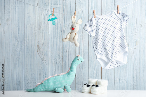 Composition with baby accessories on wooden background Canvas-taulu