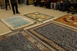 The carpets on the background in the shop for special costumers from Nevsehir, Sivas and other Turkish city in Turkey.
