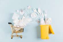 White Single Use Plastic Falling Out Of Shopping Cart In Garbage Bin.  Environmental, Pollution Concept. Flat Lay, Top View