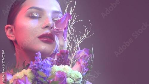 Fotografie, Obraz  Sexy brunette model girl with bouquet of beautiful flowers
