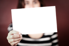 Serious Young Adult Woman Holding A Blank Sign