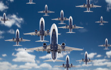 Bottom View Of Several Passenger Airplanes Flying In The Blue Sky