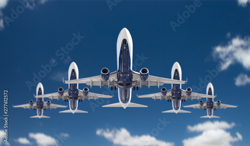 Poster Avion à Moteur Bottom View of Five Passenger Airplanes Flying In Formation In The Blue Sky