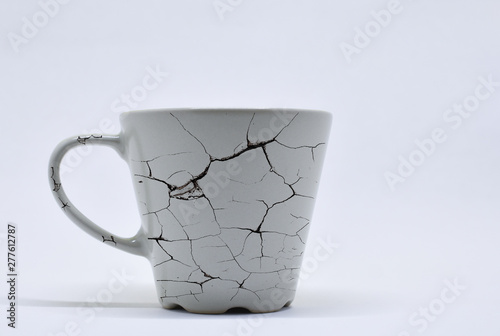 Photo beige color, ceramic mug, with crack pattern, isolated
