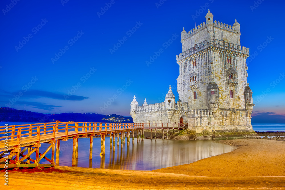 Fototapeta Ancient Belem Tower on Tagus River in Lisbon at Blue Hour in Portugal.