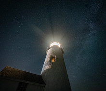 Milky Way Over A Lighthouse