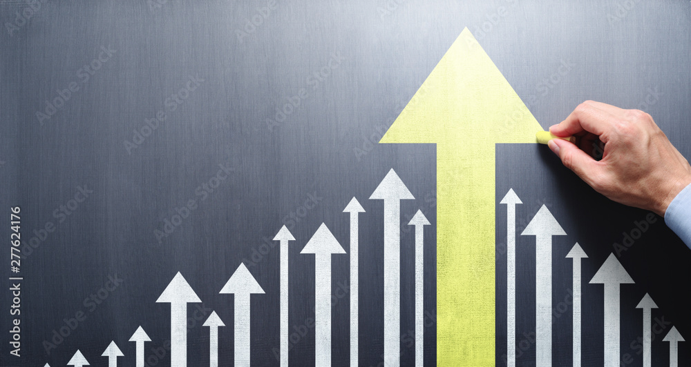Fototapety, obrazy: Business leadership and development concept. Businessman drawing growth arrow on chalkboard.