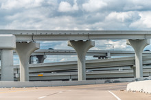 Dallas, Texas Downtown Elevated Highway In City In Summer With Trash On Ramp And Cars In Traffic