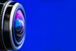 canvas print picture - Camera lens with blue backlight. Side view of the lens of camera on blue background. Blue camera Lens close Up.