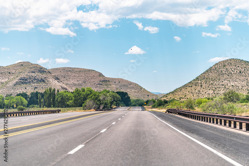 Tela  Tinnie New Mexico countryside road view from 380 highway with desert landscape a