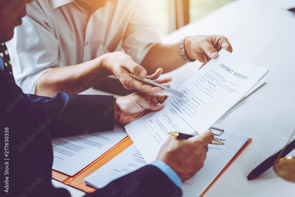Fototapety, obrazy: Group of middle age Asian business people and lawyers discussing and sign a contract.