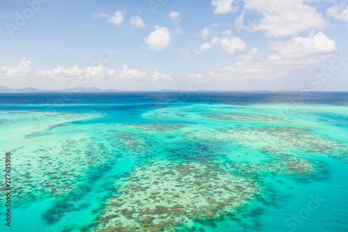 Canvas Prints Green coral Coral reefs and atolls in the tropical sea, top view. Turquoise sea water and beautiful shallows. Philippine nature.