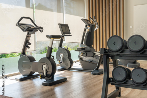 Canvas Print Sport bike and dumbbells in fitness room