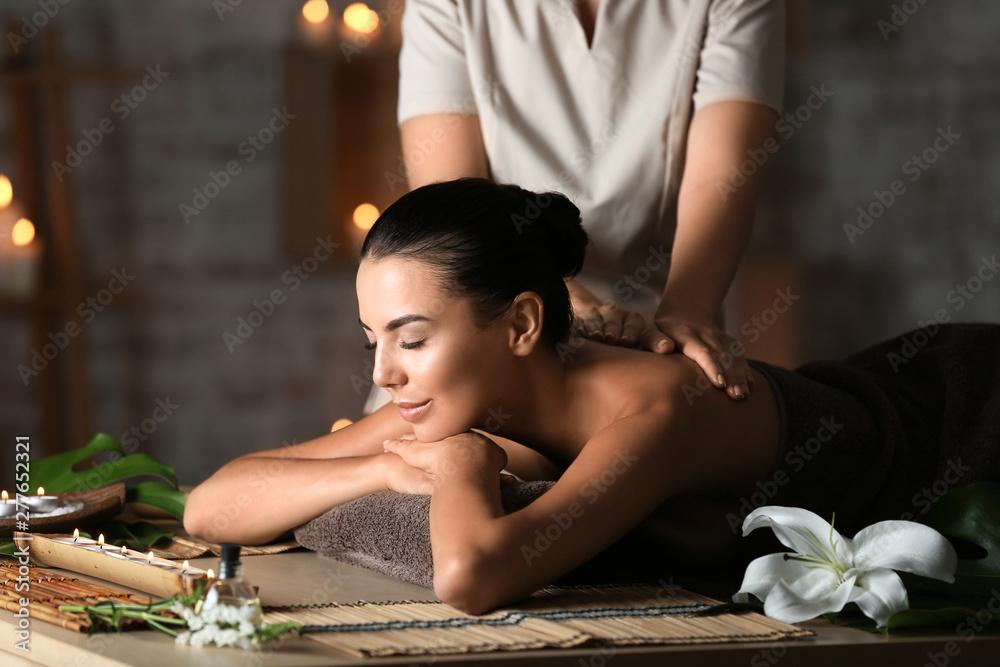 Fototapeta Beautiful young woman receiving massage in spa salon