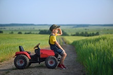 Little Boy Farmer On A Tractor...