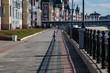 little girl running along the promenade on a hot summer day