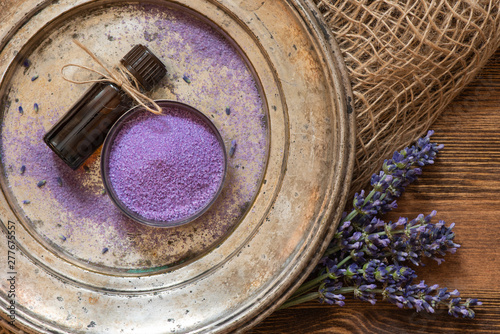 Lavender, bath salt and lavender oil on an old metal plate. - 277675557