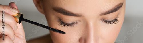 Valokuvatapetti Woman Doing Makeup, Applying Black Mascara, Closeup
