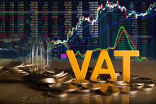 Vat Concept.Word Vat Put On Coins And Glass Bottles With Coins Inside On Black Background.Stock Market Or Forex Trading Graph And Candlestick Chart