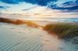 Leinwandbild Motiv Grassy dunes and the Baltic sea at sunset