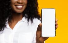 African Millennial Woman Showing Blank Cellphone Screen
