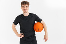 Photo Closeup Of Joyful Young Man In T-shirt Smiling And Holding Ball While Playing Basketball Game