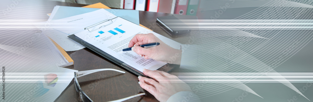 Fototapety, obrazy: Businesswoman checking a report; panoramic banner