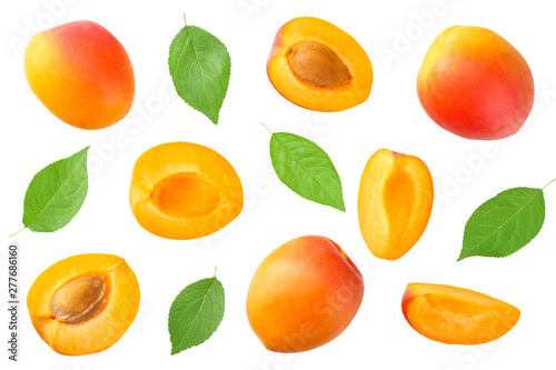 Fotografiet apricot fruits with slices and green leaf isolated on white background