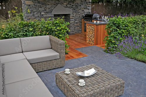 Stampa su Tela A lifestyle garden combining outdoor kitchen and indoor living in style and comf