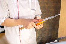 Hands Of Professional Chef Carving Carrot Prepare For Food Dish Decoration.