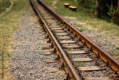 Old, rusty, abandoned railway rails, stretching into the distance Wallpaper Mural
