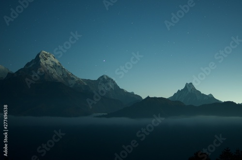 Obraz Wide shot of beautiful rocky mountains with amazing clear blue sky with stars in the background - fototapety do salonu