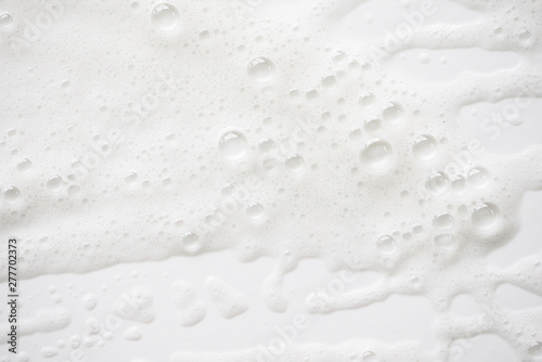 Obraz na plátně Abstract background white soapy foam texture
