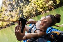 Girl Taking Selfie On A Kayak Ride