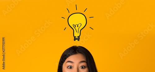 Photo  Asian girl head with idea bulb above