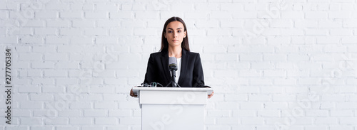 Fotografie, Obraz attractive, confident lecturer holding on podium tribune in conference hall