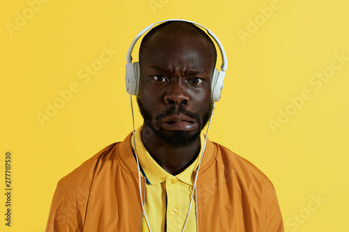 Man In White Headphones Listening Music And Making Funny