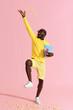 Leinwanddruck Bild - Happy man in cinema glasses having fun throwing pop corn in air