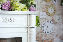 Decorative Fireplace Corner And Wall Background With Clock And Flowers