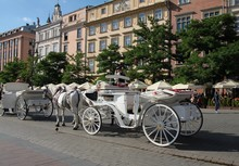 Traditional Cabs For Tourists In Krakow's Market Square