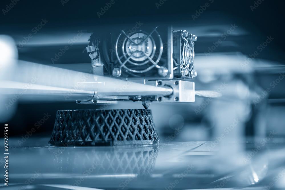 Fototapeta The 3D printing machine operation. The 3D rapid prototype processing concept.