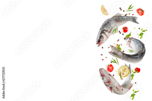 Fotomural Flying food, raw sea bass fish with spices